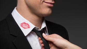 Man with lipstick on his collar