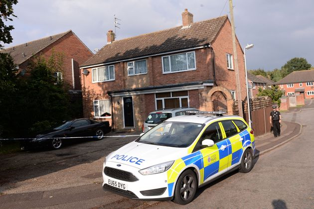 Police stand outside a house in Colchester, Essex, where a baby boy died after being attacked by a