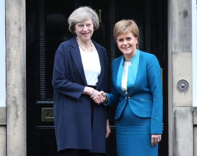 Prime Minister Theresa May (left) is greeted by Scotland's First Minister Nicola Sturgeon at Bute House...