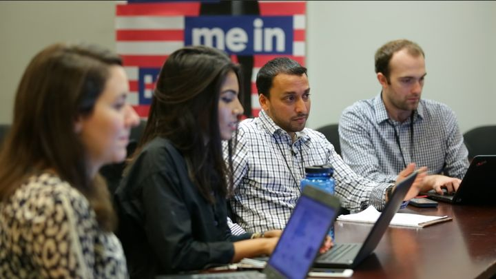 Zara Rahim, second from left, and Farooq Mitha, second from right, discuss Muslim outreach strategy in Hillary Clinton's Broo