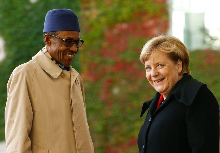 German Chancellor Angela Merkel greets Nigerian President Muhammadu Buhari in Berlin on Oct. 14, 2016.