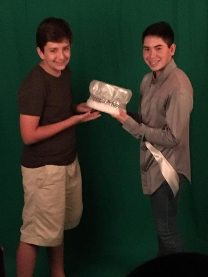 Nick's brother, Noah (L), posing with his brother'scrown.