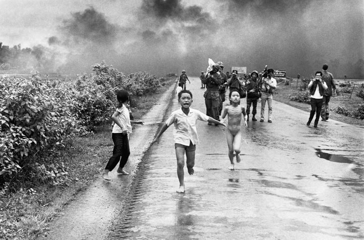 Vietnamese children flee from their homes in the South Vietnamese village of Trang Bang after South Vietnamese planes acciden