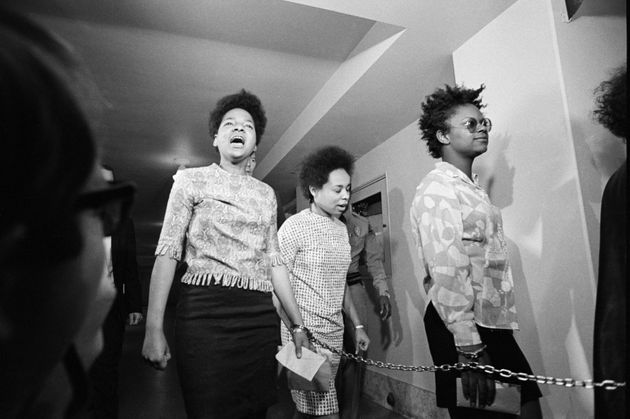 Three women members of the Black Panthers are led into court in Los Angeles. They were arraigned on charges...