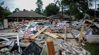 BATON ROUGE, Aug. 22, 2016 -- Photo taken on Aug. 22, 2016 shows piles of damaged belongings thrown by flood-affected families in Baton Rouge, Louisiana. Severe flooding caused by heavy rain hit the southern part of the U.S. state of Louisiana. At least 13 people have died across five parishes in Louisiana and thousands of local residents have been forced to leave home during the flood. (Xinhua/Zhang Chaoqun via Getty Images)