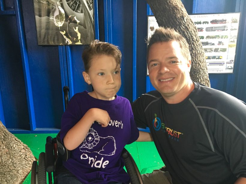 Josh Bezoni with Make-A-Wish Kid, Hayden, in his new wheelchair-accessible treehouse they built for him.