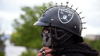 LAS VEGAS, NV - APRIL 28:  Oakland Raiders fan Eric Carrillo of Nevada arrives at a Southern Nevada Tourism Infrastructure Committee meeting at UNLV to see Raiders owner Mark Davis on April 28, 2016 in Las Vegas, Nevada. Davis told the committee he is willing to spend USD 500 million as part of a deal to move the team to Las Vegas if a proposed USD 1.3 billion, 65,000-seat domed stadium is built by casino magnate Sheldon Adelson's Las Vegas Sands Corp. and real estate agency Majestic Realty, possibly on a vacant 42-acre lot a few blocks east of the Las Vegas Strip recently purchased by UNLV.  (Photo by Ethan Miller/Getty Images)