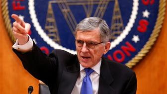 "Federal Communications Commission (FCC) Chairman Tom Wheeler gestures at the FCC Net Neutrality hearing in Washington February 26, 2015. The FCC is expected Thursday to approve Chairman Tom Wheeler's proposed ""net neutrality"" rules, regulating broadband providers more heavily than in the past and restricting their power to control download speeds on the web. REUTERS/Yuri Gripas (UNITED STATES - Tags: POLITICS SCIENCE TECHNOLOGY BUSINESS TELECOMS)"