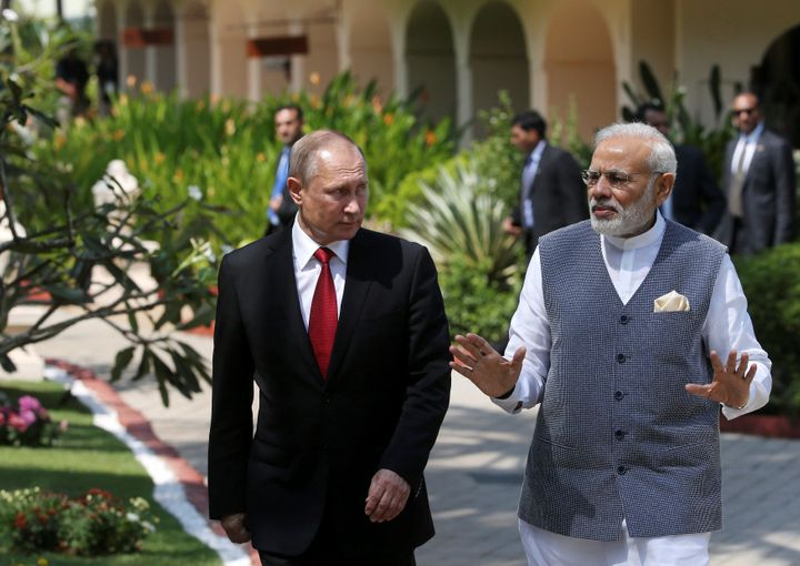 Russian President Vladimir Putin (L) and India's Prime Minister Narendra Modi walk during their meeting in Benaulim, in the w