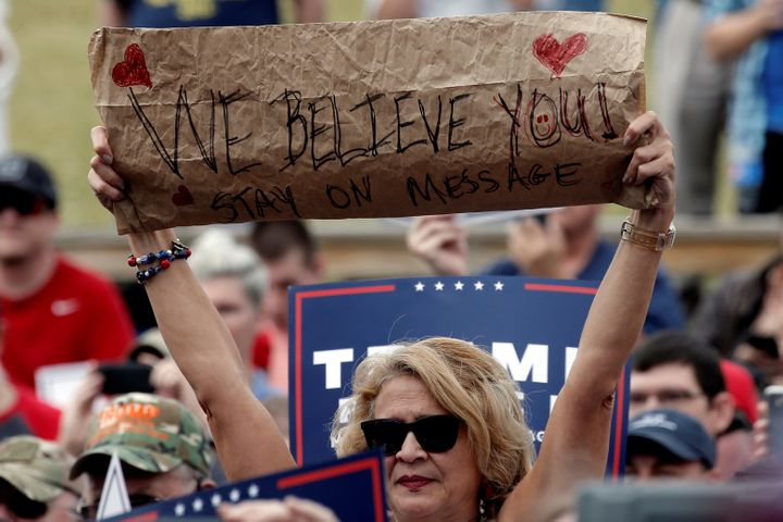 A supporter of Republican U.S. presidential nominee Donald Trump holds a sign at a campaign rally in Greensboro, North Caroli