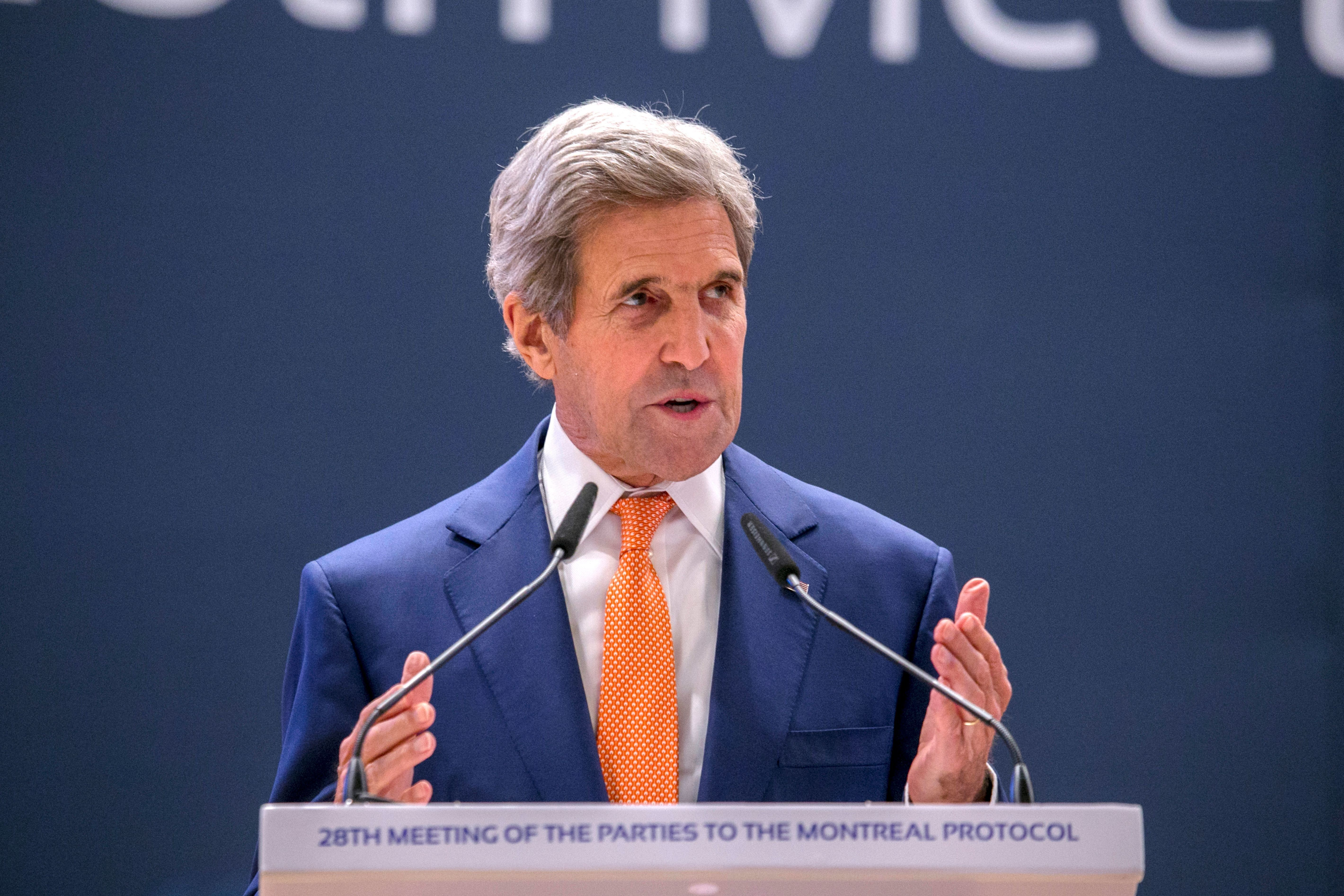 US Secretary of State John Kerry gestures as he delivers a speech during the 28th Meeting of the Parties to the Montreal Protocol in Kigali, on October 14, 2016. Hopes were high today that world envoys meeting in Rwanda will agree to phase out potent gases used in refrigerators and air conditioners that are among the biggest contributors to global warming. / AFP / CYRIL NDEGEYA        (Photo credit should read CYRIL NDEGEYA/AFP/Getty Images)
