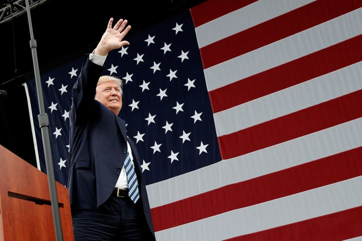 Republican U.S. presidential nominee Donald Trump waves to supporters at a campaign rally in Greensboro, North Carolina, U.S.