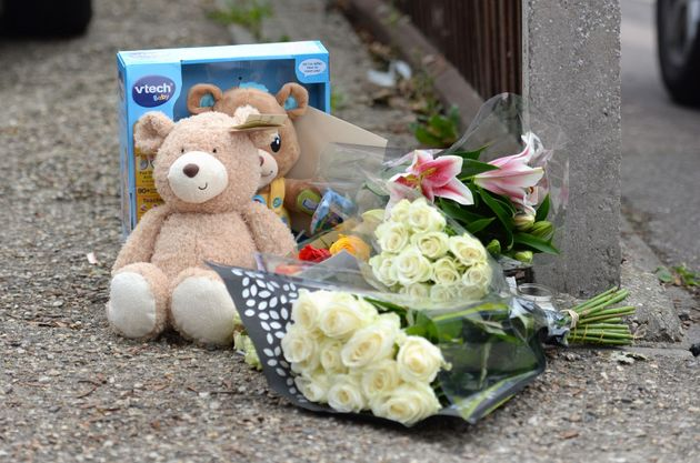 Floral tributes outside a house on the junction of Harwich Road with Tara Close in Colchester,