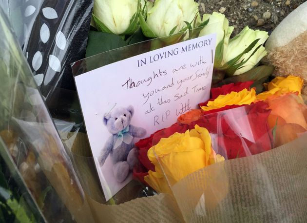 Tributes left after a baby boy was killed and his brother seriously injured in a dog attack in Colchester,