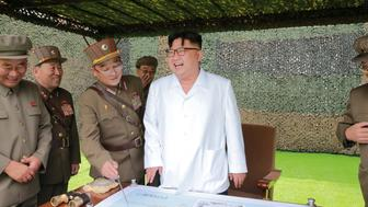 FILE PHOTO - North Korean leader Kim Jong Un provides field guidance during a fire drill of ballistic rockets by Hwasong artillery units of the KPA Strategic Force, in this undated photo released by North Korea's Korean Central News Agency (KCNA) in Pyongyang September 6, 2016. KCNA/Files via Reuters   ATTENTION EDITORS - THIS PICTURE WAS PROVIDED BY A THIRD PARTY. REUTERS IS UNABLE TO INDEPENDENTLY VERIFY THE AUTHENTICITY, CONTENT, LOCATION OR DATE OF THIS IMAGE. FOR EDITORIAL USE ONLY. NO THIRD PARTY SALES. SOUTH KOREA OUT. THIS PICTURE IS DISTRIBUTED EXACTLY AS RECEIVED BY REUTERS, AS A SERVICE TO CLIENTS.      TPX IMAGES OF THE DAY