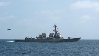 FILE PHOTO - The U.S. Navy guided-missile destroyer USS Mason conducts divisional tactic maneuvers as part of a Commander, Task Force 55, exercise in the Gulf of Oman September 10, 2016.  U.S. Navy/Mass Communication Specialist 1st Class Blake Midnight/Handout via REUTERS/File PhotoTHIS IMAGE HAS BEEN SUPPLIED BY A THIRD PARTY. IT IS DISTRIBUTED, EXACTLY AS RECEIVED BY REUTERS, AS A SERVICE TO CLIENTS. FOR EDITORIAL USE ONLY. NOT FOR SALE FOR MARKETING OR ADVERTISING CAMPAIGNS.