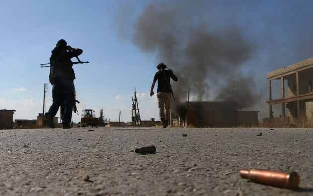 Fighters from the Free Syrian Army fight against the Islamic State (IS) group jihadists on the outskirts...