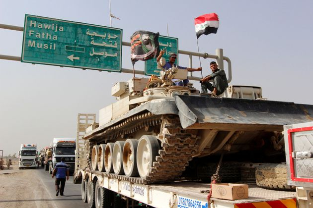 A convoy of Iraqi security forces advances on the outskirts of Mosul, to fight against Islamic State...