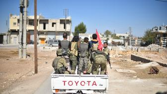 ALEPPO, SYRIA - OCTOBER 16: A convoy belonging to the Members of Free Syrian Army (FSA), enters Dabiq village of Aleppo after drove Deash terrorists from the village in Aleppo, Syria on October 16, 2016.  The villages were cleared as part of Turkeys Operation Euphrates Shield.  Dabiq has a symbolic importance for Daesh, as the group believes it will be the site of an end-times battle with non-Muslims. (Photo by Yasir Al Ahmed/Anadolu Agency/Getty Images)