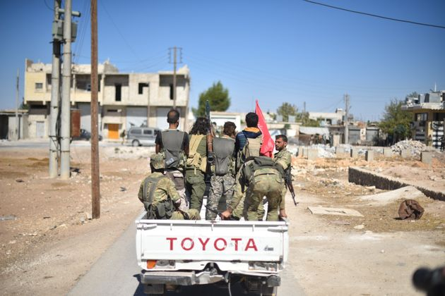 A convoy belonging to the Members of Free Syrian Army (FSA), enters Dabiq village of Aleppo after drove...