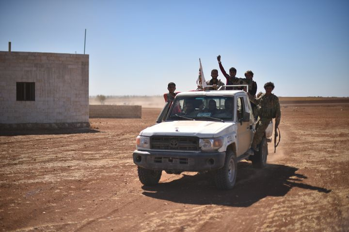 A convoy belonging to the Members of Free Syrian Army enters Dabiq, nearAleppo, after drivingISISterrorists