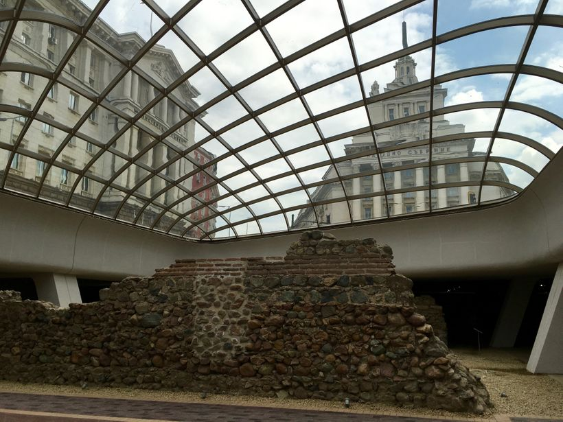 Explore Roman ruins alongside the former Communist Party Building