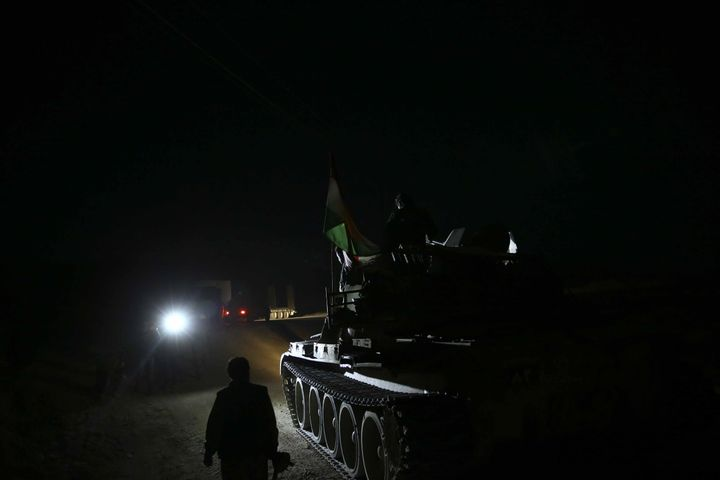 Kurdish Peshmerga forces near Wardak village, in northern Iraq, ahead of the operation to retake Mosul from ISIS on Oct.