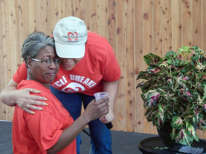 Consoling Kimberly Foster as she grieves for her son, Dwight Foster, lost to sickle cell disease.