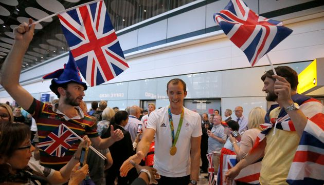 Team GB Olympians and Paralympians were welcomed by cheering crowds at Heathrow on their return...