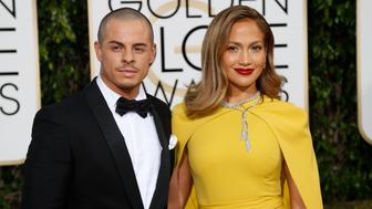 Actors Casper Smart and Jennifer Lopez arrive at the 73rd Golden Globe Awards in Beverly Hills, California January 10, 2016.  REUTERS/Mario Anzuoni