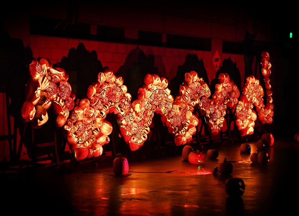 A Chinese dragon made from illuminated pumpkins.