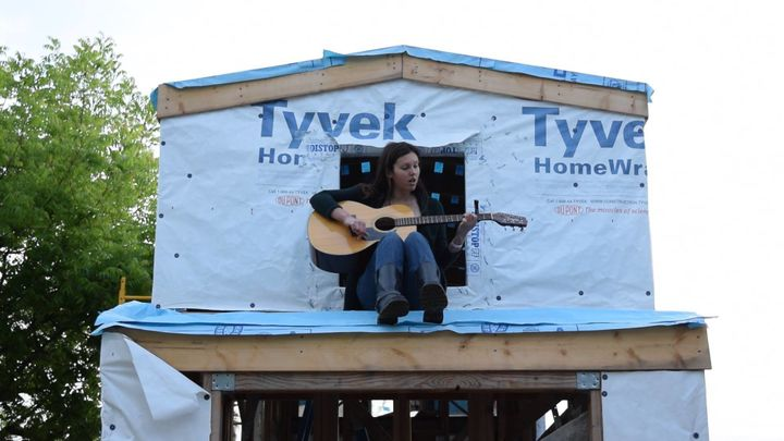 Malinda Crichton perches in the loft of the tiny home she is building.