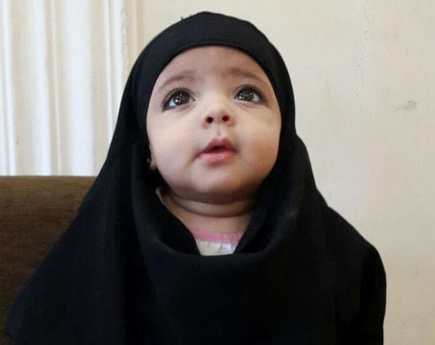 Warida and Nashwan's niece, who is cloaked in black fabric like many women and girls living under...