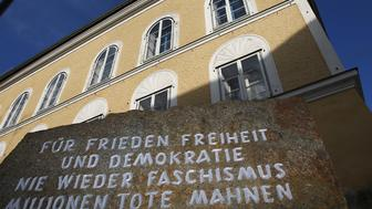 A stone outside the house in which Adolf Hitler was born, with the inscription 'For peace, freedom and democracy, never again fascism, millions of dead are a warning' in Braunau am Inn, Austria, is seen in this September 24, 2012 file photo. REUTERS/Dominic Ebenbichler/Files