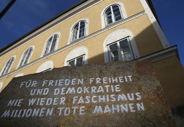 A stone outside the house in which Adolf Hitler was born, reads 'For peace, freedom and democracy, never again fascism, milli