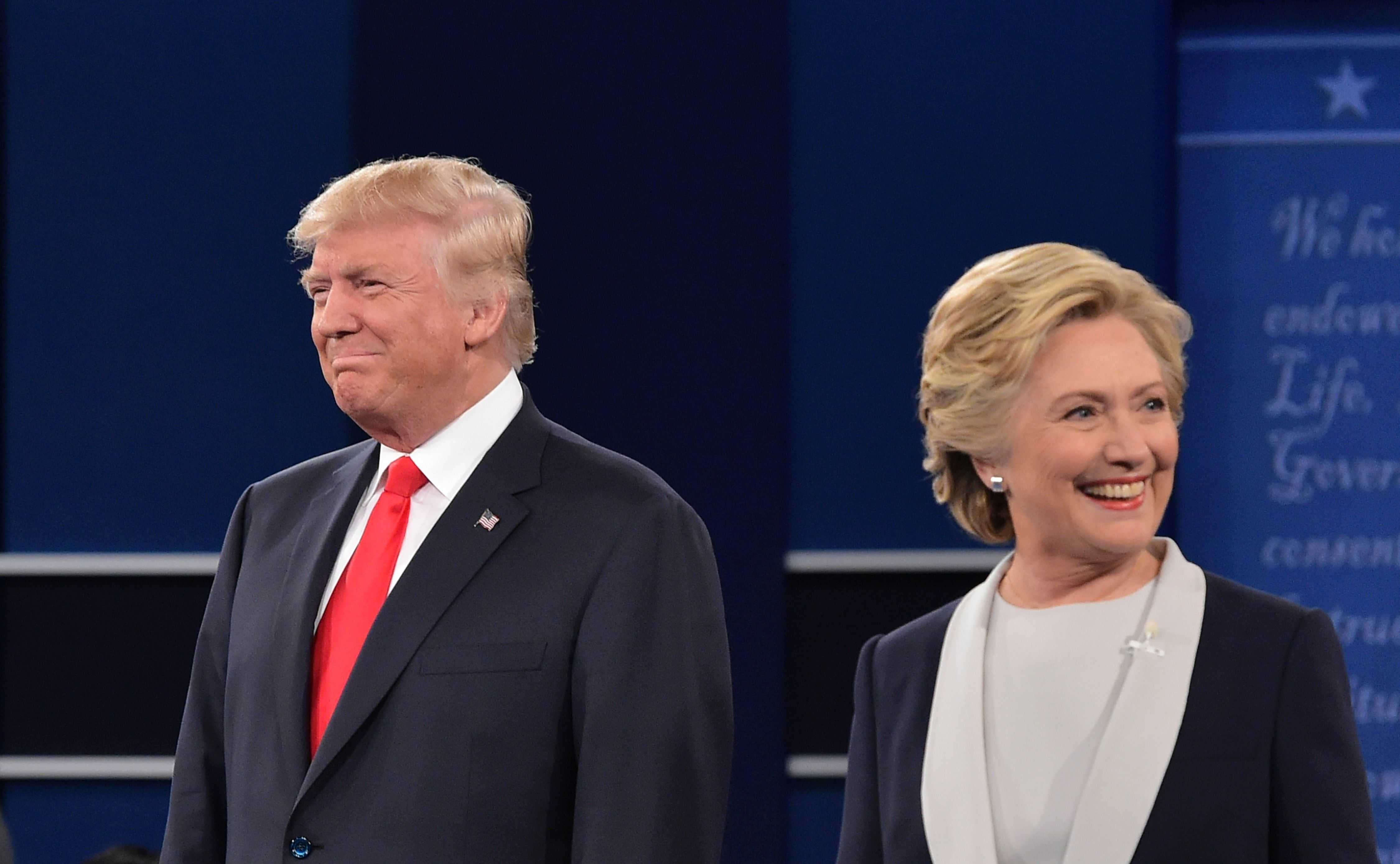 Donald Trump and Hillary Clinton arrive on stage for the second presidential debate on Oct. 9, 2016.