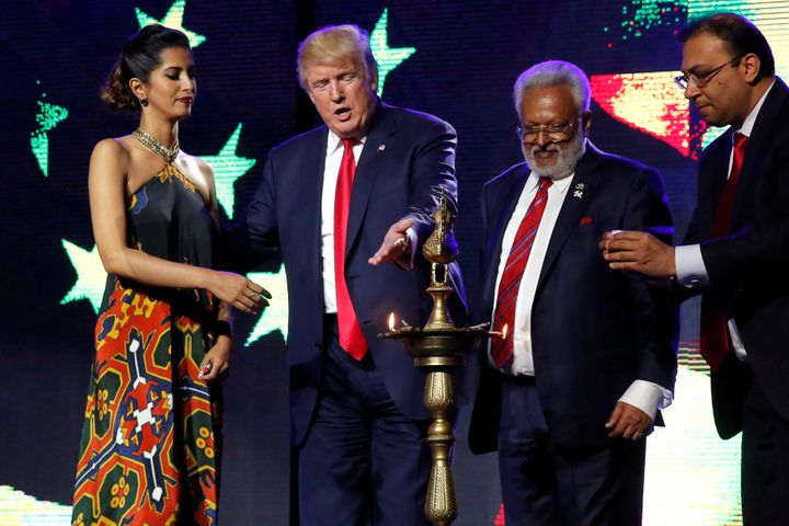 Republican presidential nominee Donald Trump enlists the help of Republican Hindu Coalition Chairman Shalli Kumar (2nd R) and