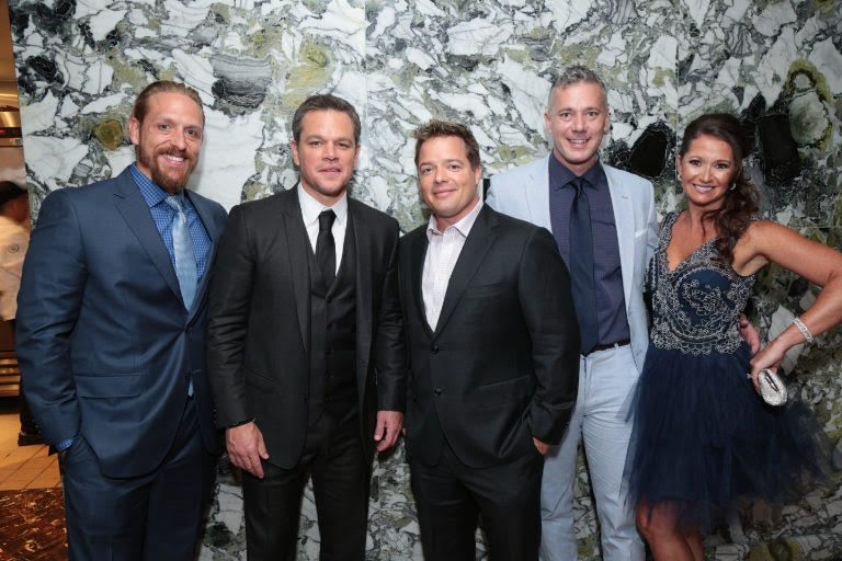 BioTrust team hanging out with Matt Damon; one of the perks of being as charitable as they are. Josh Bezoni right of Matt Dam