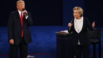 Hillary Clinton, 2016 Democratic presidential nominee, and Donald Trump, 2016 Republican presidential nominee, speak during the second U.S. presidential debate at Washington University in St. Louis, Missouri, U.S., on Sunday, Oct. 9, 2016. As has become tradition, the second debate will resemble a town hall meeting, with the candidates free to sit or roam the stage instead of standing behind podiums, while members of the audience -- uncommitted voters, screened by the Gallup Organization -- will ask half the questions. Photographer: Andrew Harrer/Bloomberg via Getty Images