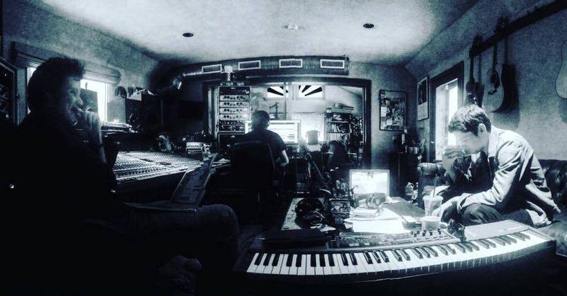 Warren and Damian in the studio working long hours