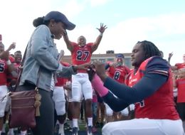 College Football Player And His Teammates Pull Off Winning Proposal