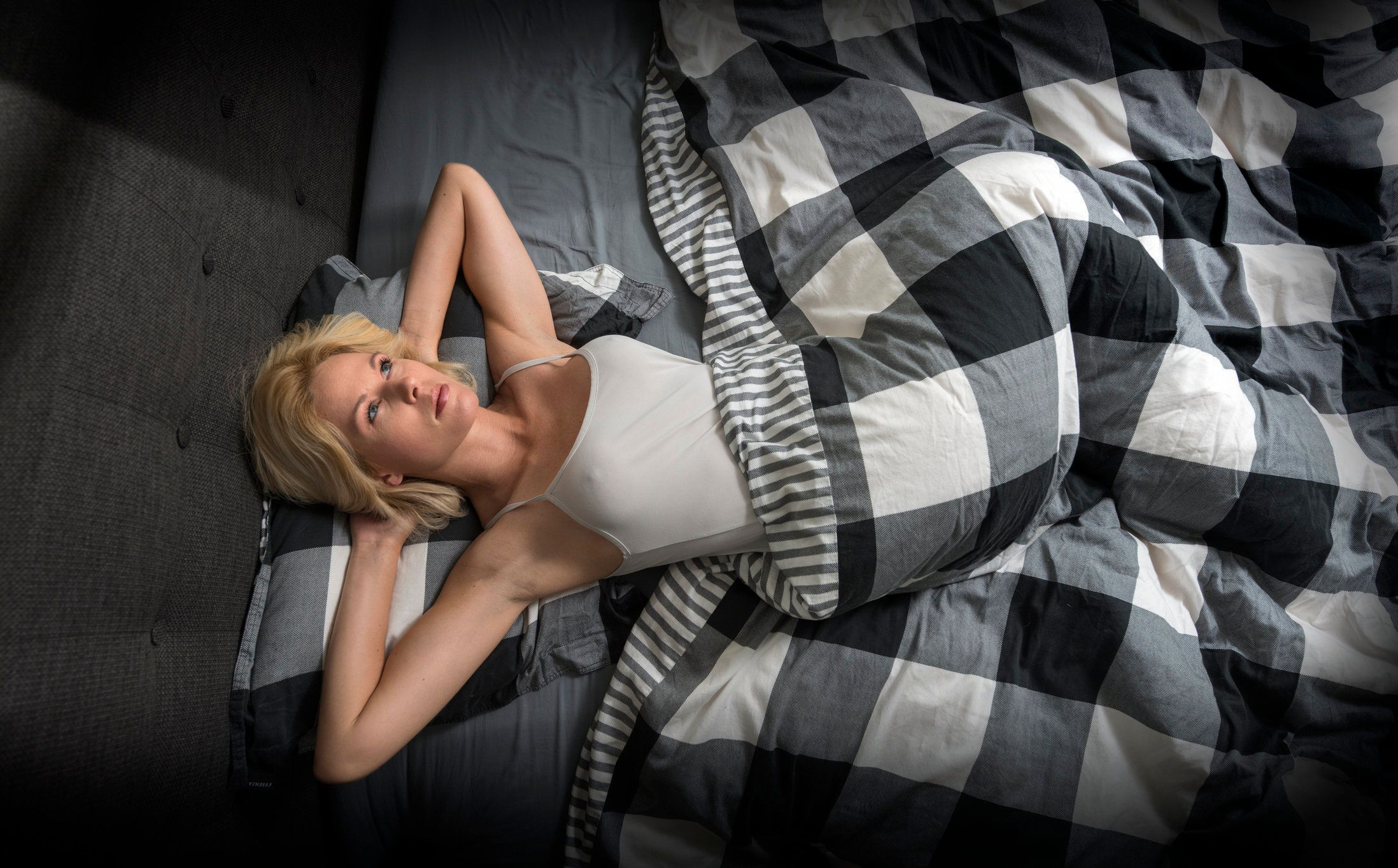 Blond Woman can't sleep at  night because of her problems