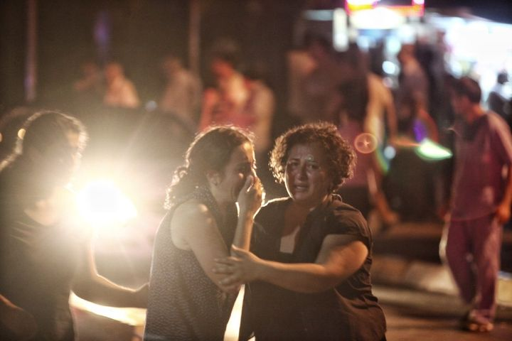 Relatives of the Ataturk Airport suicide bomb attack victims wait outside Bakirkoy Sadi Konuk Hospital, in the early hours of