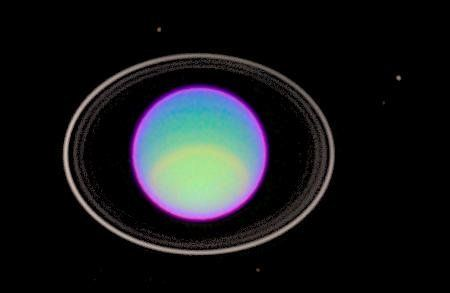 Uranus and its rings seen in a false-color image taken by the Hubble Space Telescope in 1995. The...