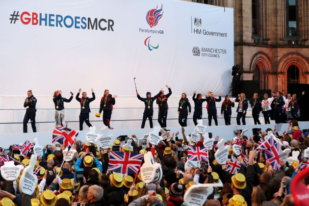 The people of Manchester braved the rain to welcome home the Olympians and
