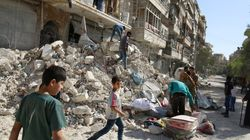 Russian, Syrian Forces Halt Airstrikes On