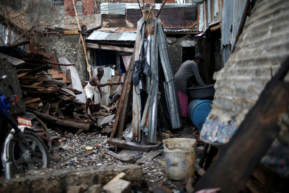 Haitians try to rebuild their destroyed houses onOct. 16, 2016.