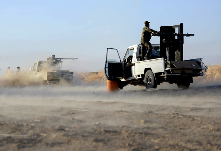 Peshmerga forces attack ISIS targets on Oct. 17 near Mosul.