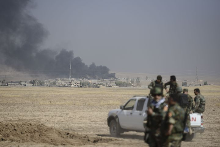 Smoke rises over Tarjala village Monday as Peshmerga forces attack ISIS targets during an operation to liberate Mosul.