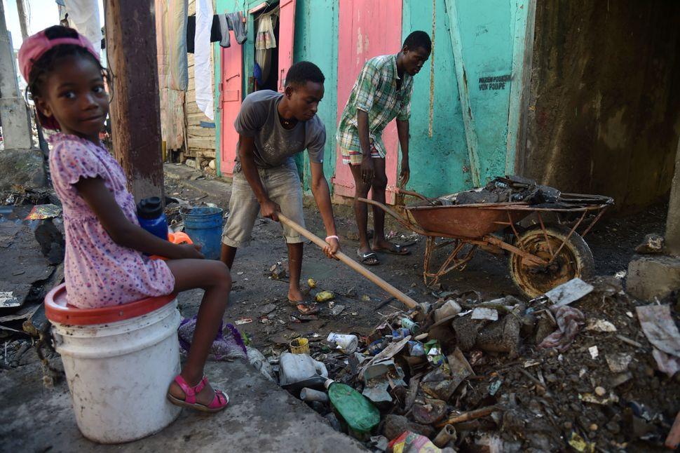 Residents clean debris on Oct. 8, 2016.